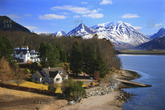 Houses on the coast of Loch Leven with Pap of Glencoe in the background, Scotland