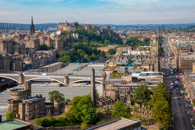 View across Waverely Station and Princes Street towards Edinburgh Castle, Scotland