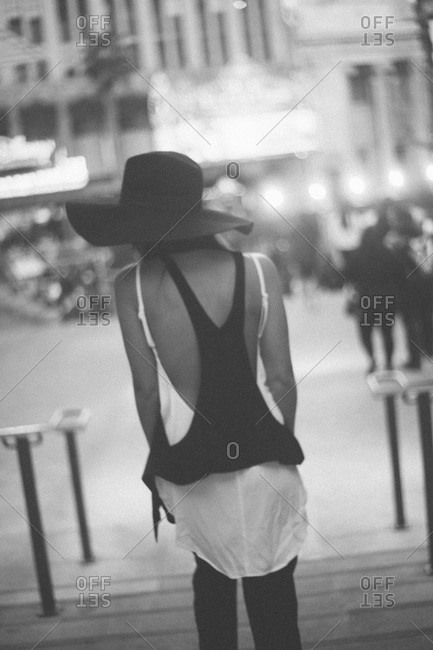 Woman in elegant hat walking in the city