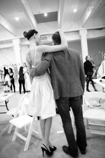 Back view of fashion model posing with a man