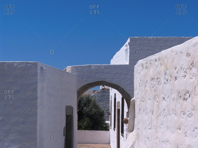 Whitewashed building under a clear blue sky