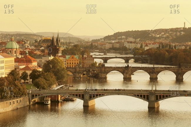 Bridges over the Vltava River including Charles Bridge, and Old Town Bridge Tower at sunset, Prague, Bohemia, Czech Republic, Europe