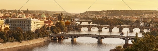 Bridges over the Vltava River including Charles Bridge, and the Old Town Bridge Tower at sunset, Prague, Bohemia, Czech Republic, Europe