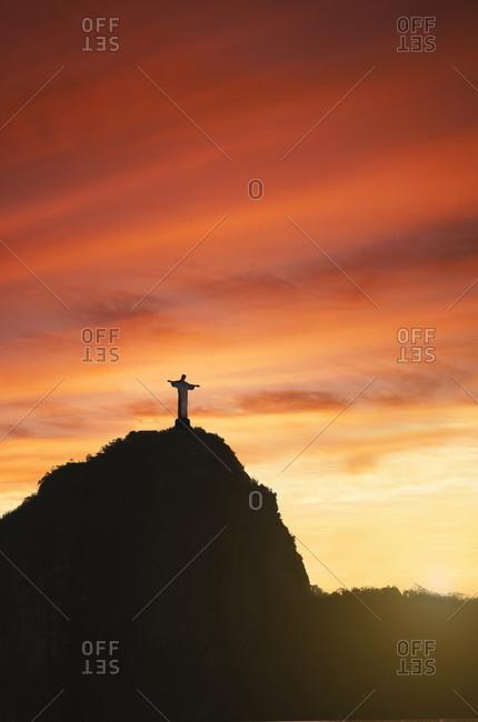 Statue of Christ the Redeemer at sunset, Corcovado, Rio de Janeiro, Brazil, South America - November 28, 2009