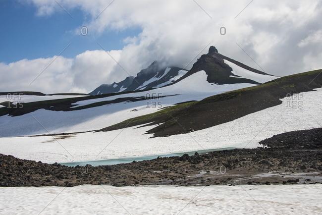 Snowfield below Mutnovsky volcano, Kamchatka, Russia, Eurasia