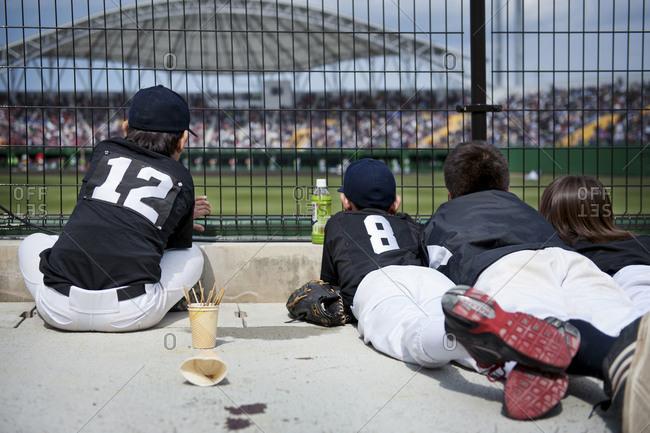 Children watching a game at a baseball field