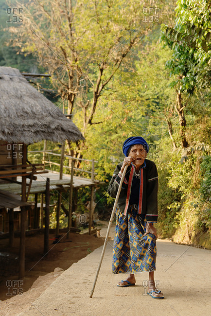 Thailand - January 7, 2014: Elderly woman leaning against her staff