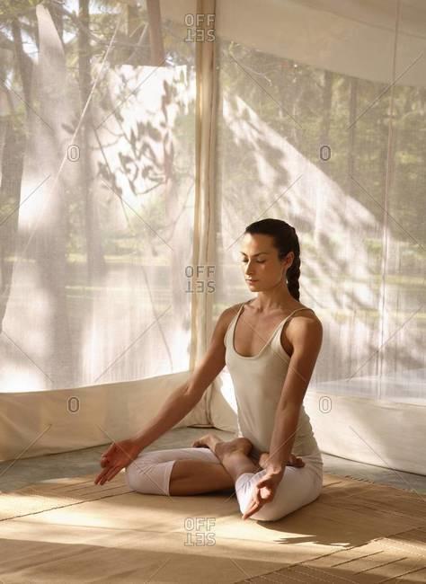 Yoga, lotus posture, in tent at Shreyas Retreat, Bangalore, India, Asia