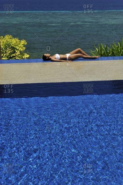 Girl at the pool at Eskaya Beach Resort and Spa, Bohol, Philippines, Southeast Asia, Asia