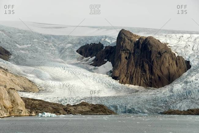 Outlet glaciers descending from main ice sheet, along north side of Prins Christian Sund, southern tip of Greenland.