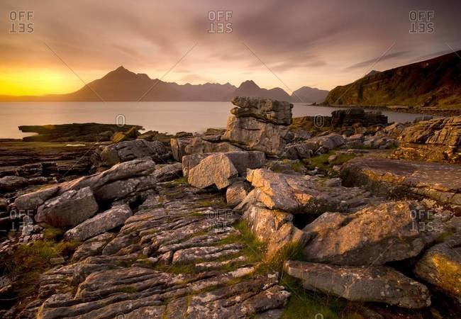 Sunset view over rocky foreshore to the Cuillin Hills from Elgol, Isle of Skye, Highland, Scotland, United Kingdom, Europe