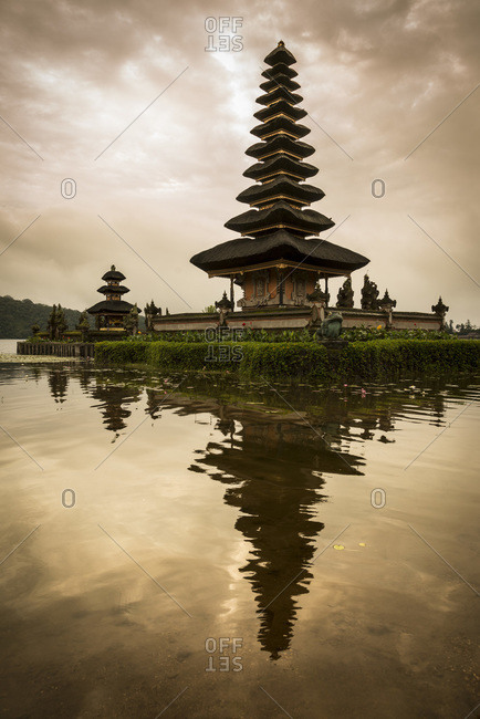 Sunrise at the Pura Ulun Danu Bratan temple, on a small island surrounded by a lake in Bali, Indonesia