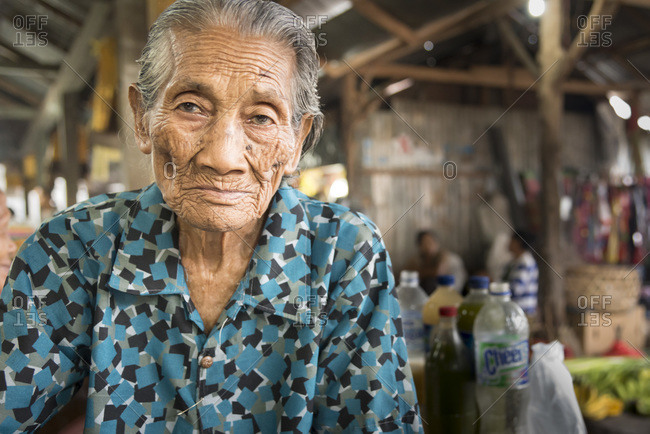Munduk, Bali, Indonesia -  January 5, 2013: Portrait of a woman working in the market