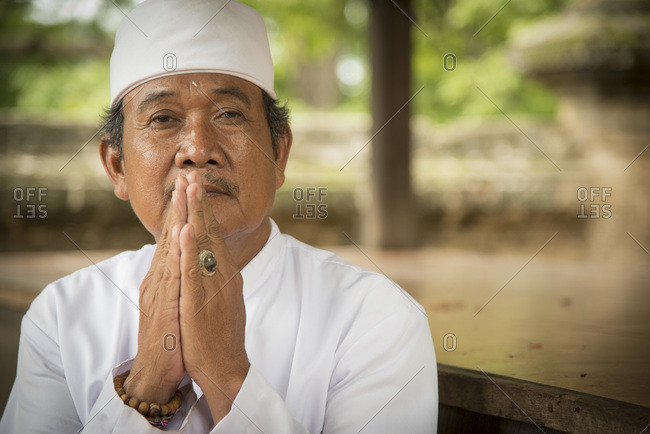 Gerokgak, Bali, Indonesia -  January 5, 2013: Portrait of a temple priest, Bali, Indonesia