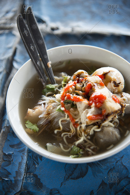 A bowl of bakso soup with noodles and meatballs in Bali, Indonesia.