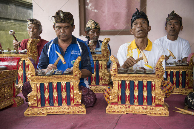 Bali, Indonesia - January 10, 2013: Men play in a gamelan orchestra in a small village