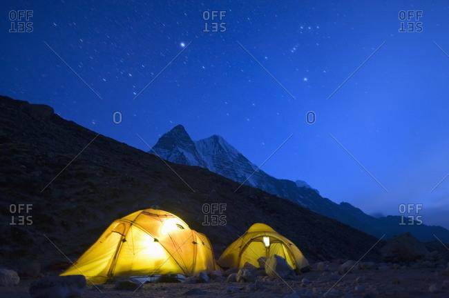 Illuminated tents at Island Peak Base Camp, Solu Khumbu Everest Region, Sagarmatha National Park, Himalayas, Nepal, Asia