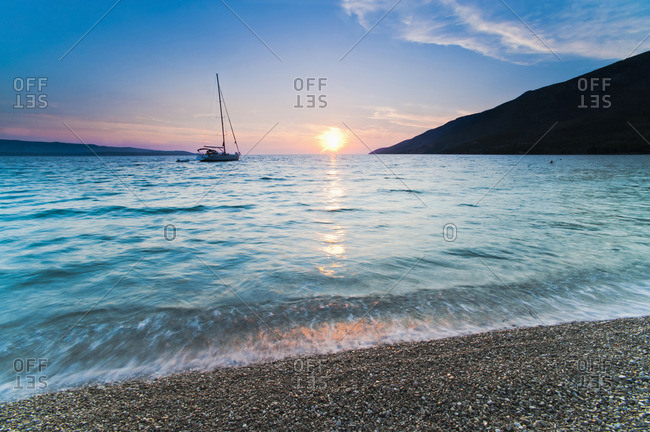 Adriatic Sea off Zlatni Rat Beach at sunset, Bol, Brac Island, Dalmatian Coast, Croatia, Europe