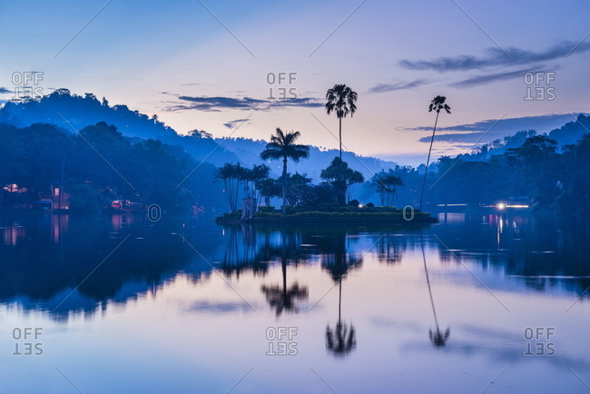 Kandy Lake and the island which houses the Royal Summer House at dawn, Kandy, Central Province, Sri Lanka, Asia