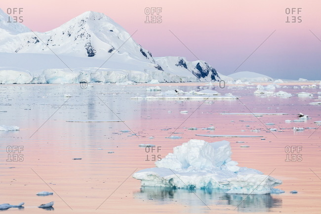 Sunset over icebergs in the Gerlache Strait, Antarctica, Southern Ocean, Polar Regions