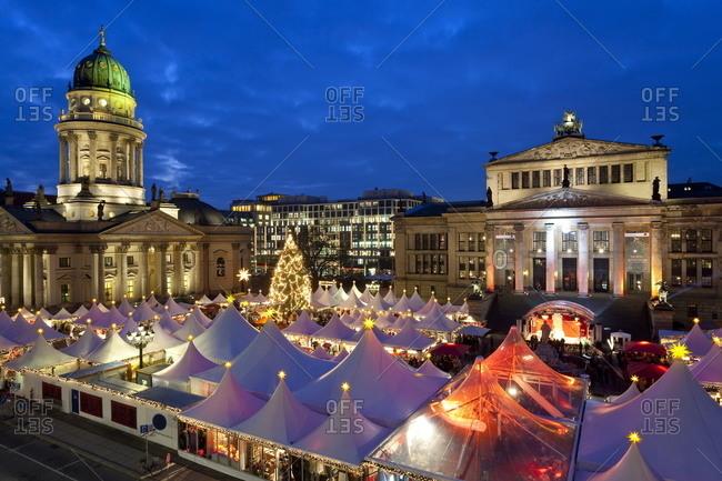 Traditional Christmas Market at Gendarmenmarkt, illuminated at dusk, Berlin, Germany