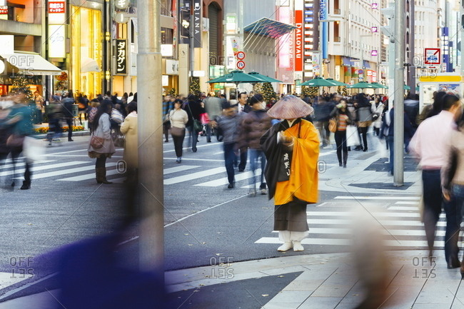 Ginza, Tokyo, Honshu, Japan, Asia - December 11, 2010: Shinto monk in traditional dress collecting alms (donations).