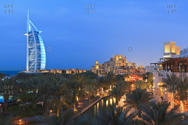 Dubai, United Arab Emirates, Middle East - March 13, 2011: Burj Al Arab viewed from the Madinat Jumeirah Hotel at dusk, Jumeirah Beach.