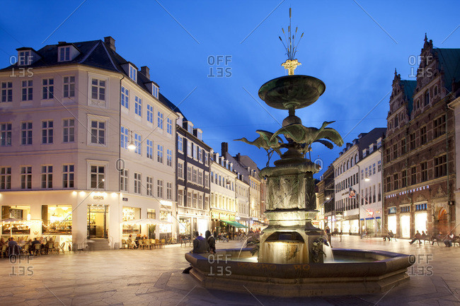 Restaurants and fountain at dusk, Armagertorv, Copenhagen, Denmark, Scandinavia