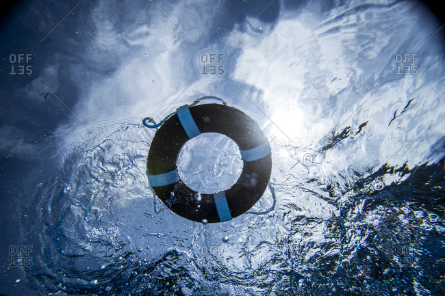 Underwater view of life preserver floating