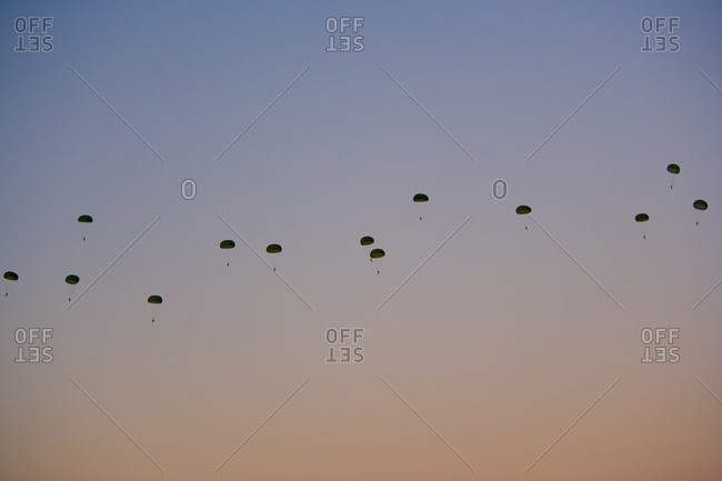 Paratroopers midair at an airborne school in Fort Benning, Georgia
