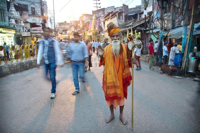 A Saddhu holy man on a busy street in Varanasi, India