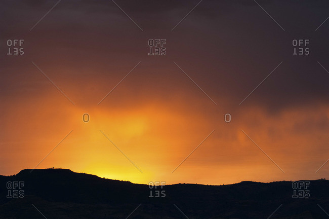 Sunset behind the ridge of hill