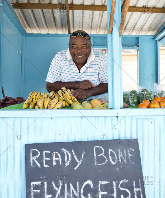 Roadside vendor selling fruit and flying fish, a staple in Barbados