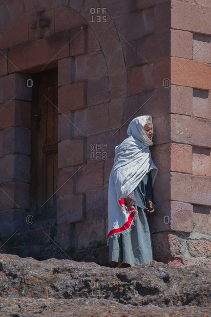 A woman watches the Timket procession in Lalibela, Ethiopia