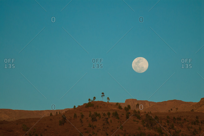 The moon rising over the mountains of Lalibela, Ethiopia