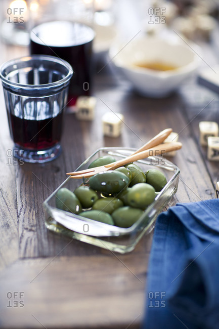 Green olives served in a glass bowl