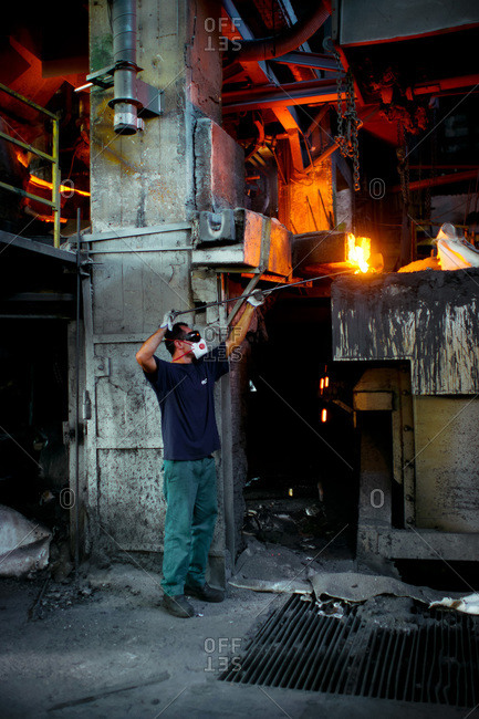 Laborer at work in a foundry