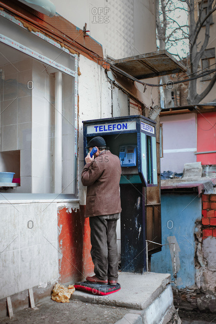 Man talking on a public telephone in Istanbul, Turkey