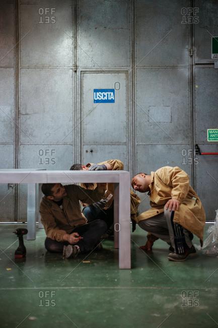 San Patrignano, Rimini, Italy - April 5, 2011: Carpenters examining a wooden table