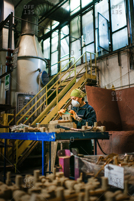 Fonderia SCM Group, Rimini, Italy - October 17, 2012: Female worker at a foundry