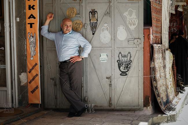 Gerusalem, Israel - April 27, 2013: Antiquities dealer standing outside his shop in Israel