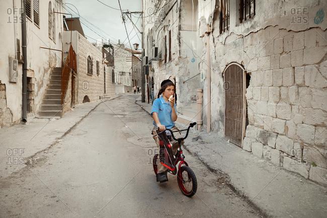 Gerusalem, Israel - April 30, 2013: Jewish boy riding a bicycle in Israel