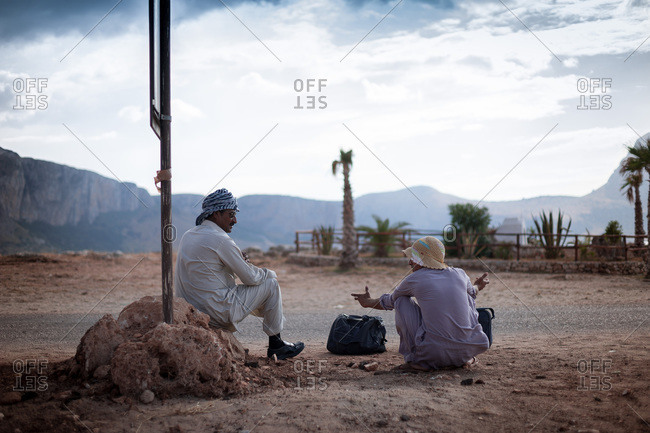 Sicily, Italy - August 20, 2008: Men talking at the side of the road
