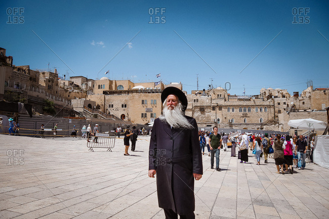 Gerusalem, Israel - April 27, 2013: Elderly Jewish man standing in front of the Wailing Wall, Israel
