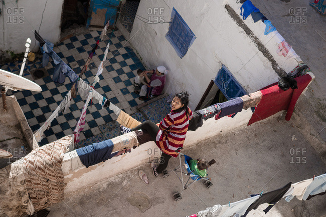 Ouarzazate, Morocco - January 8, 2012: High angle view of a young mother with her child in Morocco