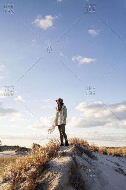 Woman standing on a sand dune