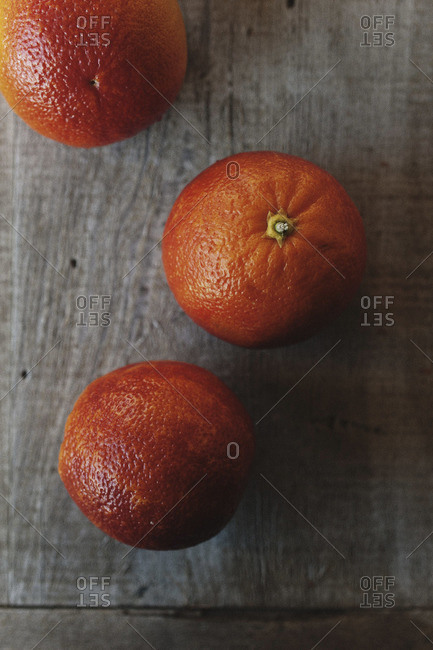 Top view of three blood oranges