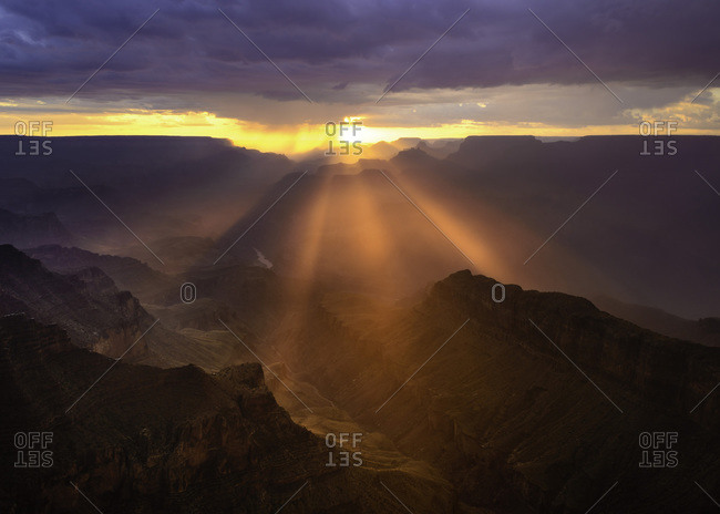 God beams stream through the Grand Canyon.