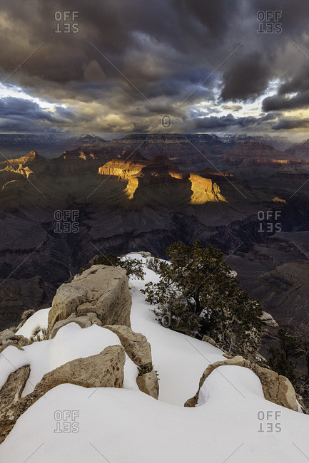 A winter sunset from the snowy Pima Point on the South Rim of Grand Canyon National Park.