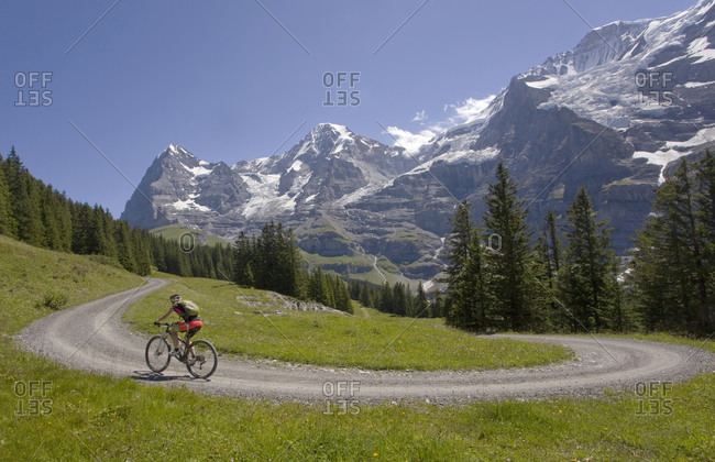 Road Cycling, Riding Road Cycling up a switchback in sunshine,Switzerland